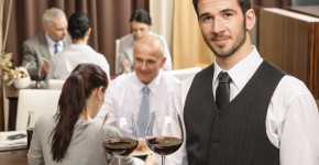 Waiter hold wine glasses business lunch restaurant