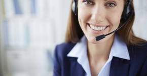 Smiling face of a pretty phone agent